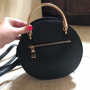 Black circle purse with long strap